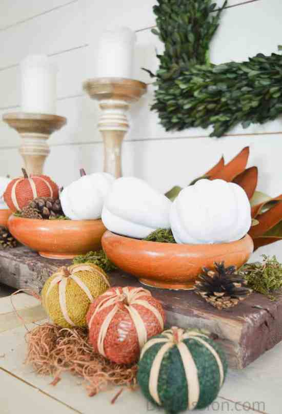 Burlap pumpkins, painted gourds and a reclaimed wood centrepiece