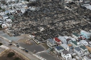 People (bottom) walk near the remains of burned homes after Hurricane Sandy in the Breezy Point neighborhood of the Queens borough of New York City. Over 50 homes were reportedly destroyed in a fire during the storm. (Mario Tama/Getty Images)