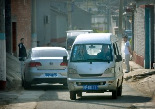 "Typical illegal taxi van ""black taxi"" in Beijing"