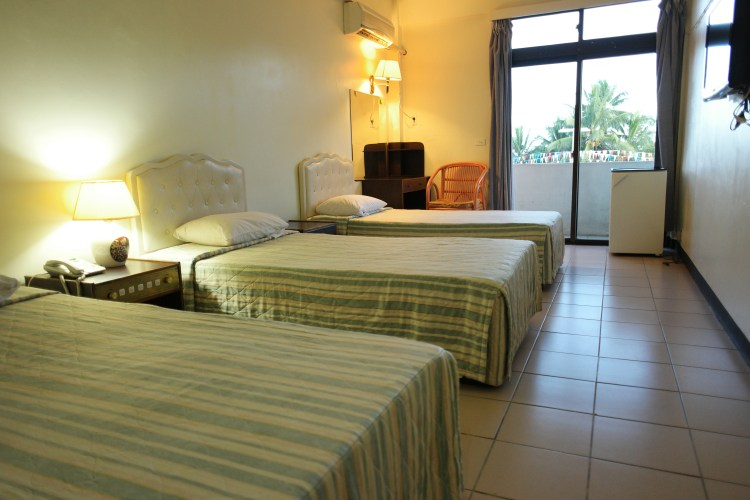 One of the triple rooms, equipped with satellite channels, fridge, air condition, balcony, private bathroom, liens and towels.