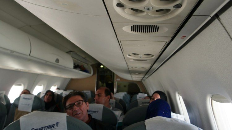Egyptair logo is all over the interior of the aircraft