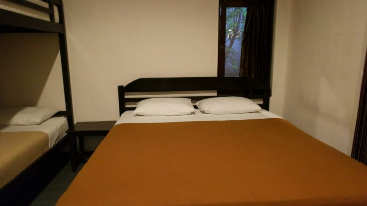 Family room features a king bed and a two dorm bed, as well as a private bathroom and locker