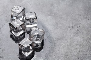 Treating Cheeks Pimples With Ice Cubes