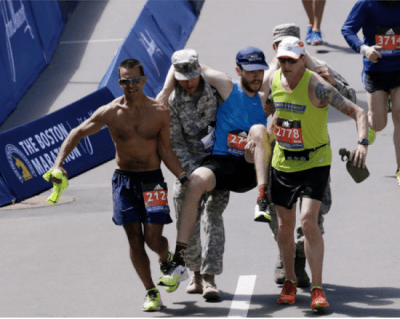 Mike Korfhage Helped Carry a Runner at the 2017 Boston Marathon