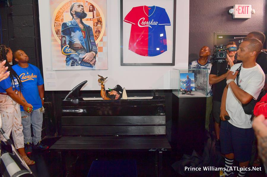 T.I. Unveils Nipsey Hussle Installation At Trap Music Museum