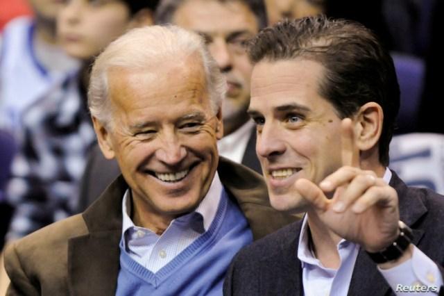FILE PHOTO: U.S. Vice President Joe Biden and his son Hunter Biden attend an NCAA basketball game between Georgetown University…