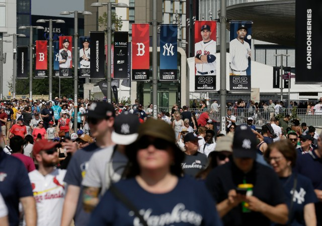 Fans arrive before a baseball game between the Boston Red Sox and the New York Yankees, Saturday, June 29, 2019, in London. Major League Baseball makes its European debut game today at London Stadium. (AP Photo/Tim Ireland)