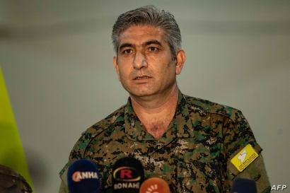 Redor Khalil, a Kurdish official in the Syrian Democratic Forces (SDF), speaks during a press conference in the northeastern…