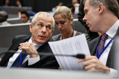 White House trade adviser Peter Navarro, left, attends the opening session of an extraordinary congress of the Universal Postal Union (UPU) in Geneva, Sept. 24, 2019.
