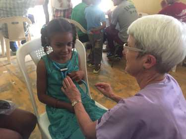 Dr. Rebecca Shaw with a 8-year-old patient in the Dominican Republic