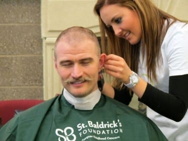 Kyle Bockelman, D.O.'16, loses his mane (but not the moustache)