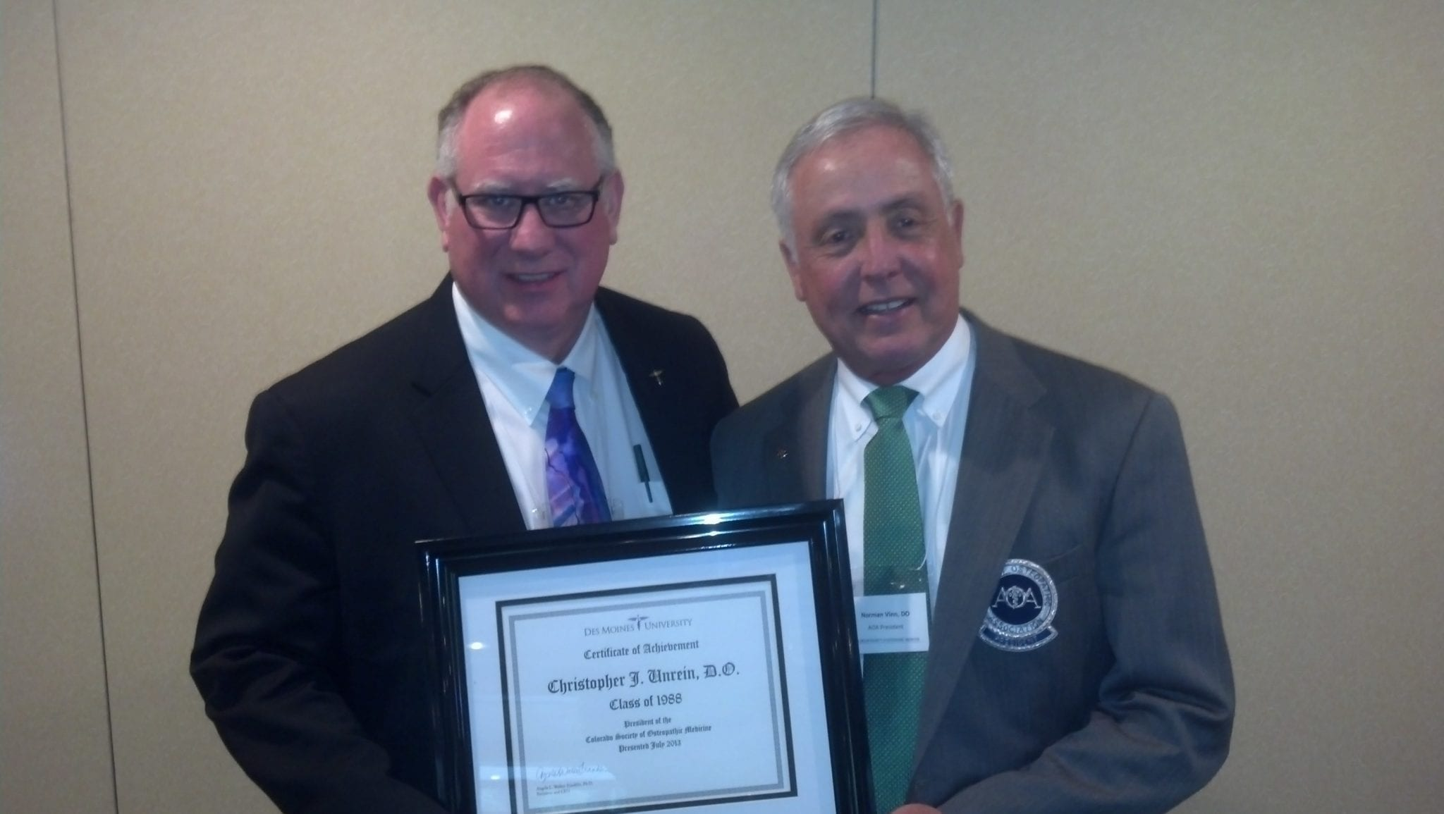 Christopher J. Unrein, D.O.'88, with Dr. Norman Vinn, AOA president
