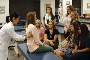DMU's OMM fellows provide a demonstration for Waukee APEX students.