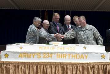 From left, Chief of Staff of the Army Gen. George W. Casey Jr., DMU alumnus Col. Arthur Wittich, Deputy Secretary of Defense William Lynn, Secretary of the Army Pete Geren, Private Rex Vaughn (the youngest Soldier serving in the military district of Washington), and Sergeant Major of the Army Kenneth Preston cut the Army's 234th birthday cake during a celebration at the Pentagon in Washington, D.C., on June 12, 2009.