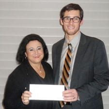 Justin Bloomberg receives a $1,000 scholarship award from Kathie J. Lyman