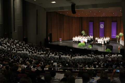 DMU students don their white coats and take the oath at the annual rite of passage.