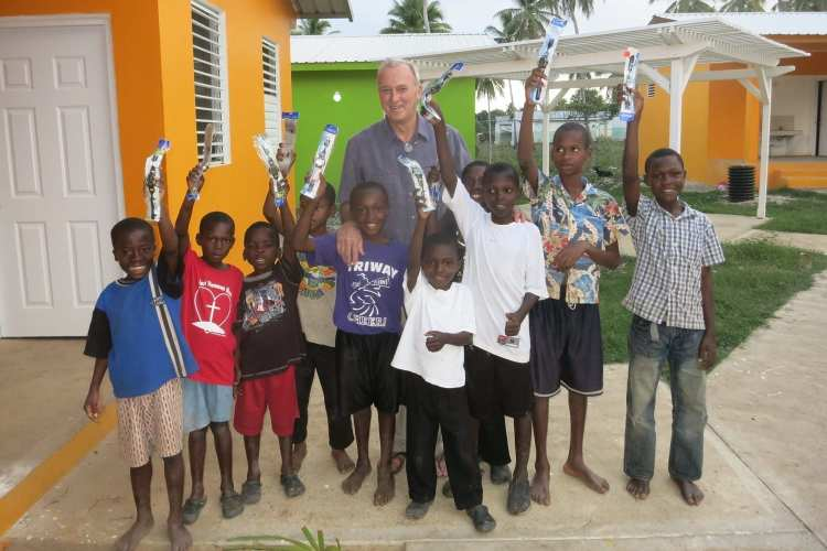Rick Wilkerson, D.O.'80, and the orphans of La Concorde in Haiti.