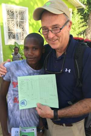 The students of La Concorde love to share their academic achievements and school work with Rick Wilkerson.