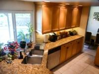 Angled Wall Transforms Corridor Kitchen
