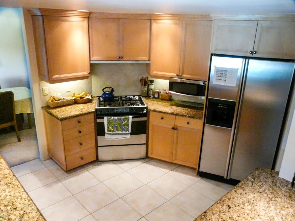 fluorescent light fixtures living room white with dark wood floors angled wall transforms corridor kitchen - danilo nesovic ...
