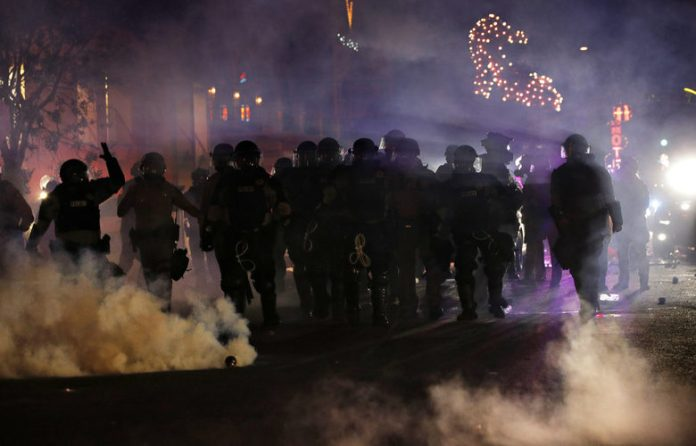 Cities in the United States imposed a curfew after the fifth night of fierce clashes
