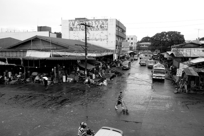 BACOLOD has three major wet and dry public markets - South or Libertad, North or Burgos, and Central - through which 12 streets pass through - Burgos, Galo, Daniel Ramos, Gonzaga, Luzuriaga, San Juan, Libertad or Hernaez, Amelia, Lopez Jaena, and Mabini. This is the juncture of Amelia and Lopez Jaena Streets, the southern spine of the Libertad Public Market. The portion of Amelia you can see used to be passable to only one vehicle as it was choked by vendors lining both sides of the road.  Photo by Lourdes Rae Antenor, text by Julius D. Mariveles