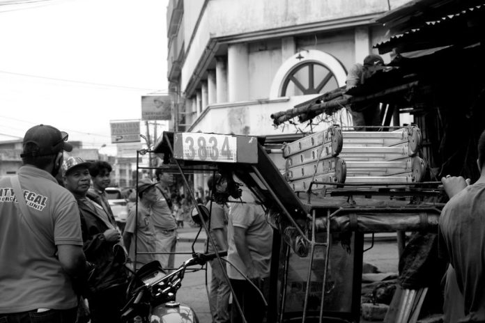 DEMOLITION MEN: Employees of the City Legal Enforcement Unit prepare to take down an illegal structure along Margarita and Lopez Jaena Streets near the Libertad Public Market.  Photo by Lourdes Rae Antenor, text by Julius D. Mariveles