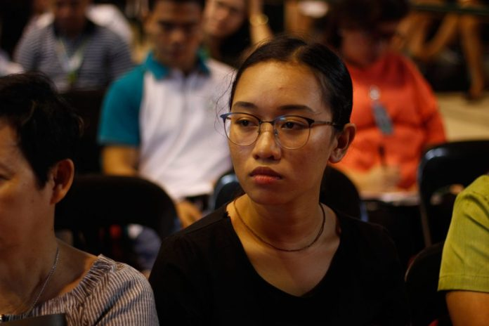 GRIM AND DETERMINED. Youth for Climate Hope lead convenor Krishna Ariola, who later acted as moderator in the forum, listens in rapt attention as the speaker applauded the youth in their efforts to save the planet.