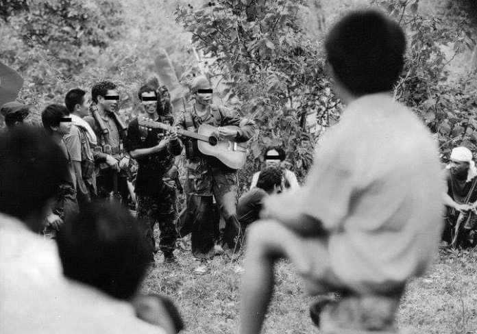 Red fighters of the New People's Army celebrate the founding of the Communist Party of the Philippines somewhere in Negros. Photo taken in the 1990s by Julius D. Mariveles