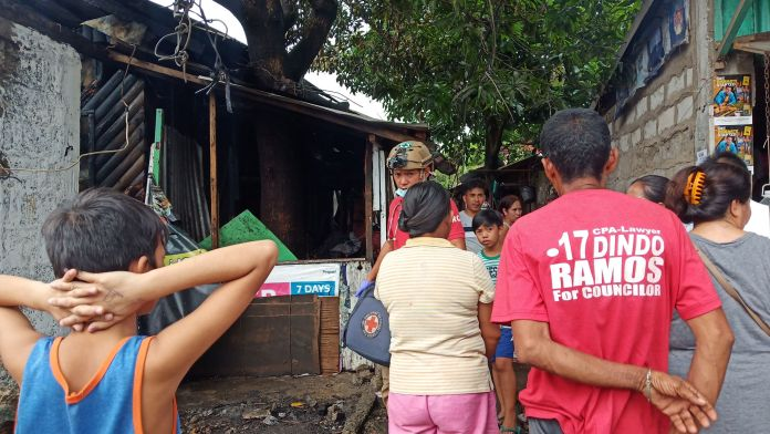Neighborhood miron.  A crowd gathers in front of the house that was the source of the fire in Barangay Bata this morning.