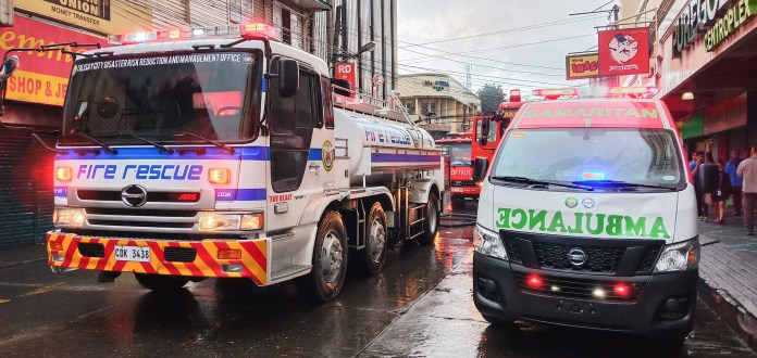 SIDE-BY-SIDE. The LGUs of Talisay and Bacolod respond to the call by DRRMO assets like the firetruck (left) and an ambulance to assist victims.