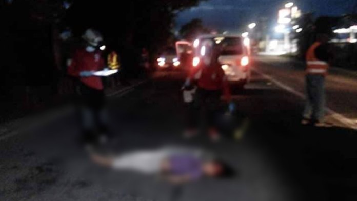 The unidentified victim's body sprawled on the road as paramedics respond to the incident. | Photo courtesy of BCPO