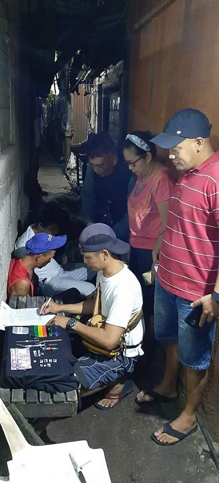 Station 1 operatives sort the evidence recovered from three suspected drug peddlers (sitting) in a buy bust operation last night. | Photo courtesy of BCPO