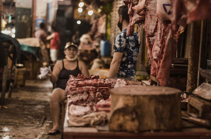 Images in a market. Prices of pork in Bacolod hiked by almost P20, market monitoring among five suppliers in Libertad South Public Market showed. | Photo by Rodney A. Jarder, Jr.
