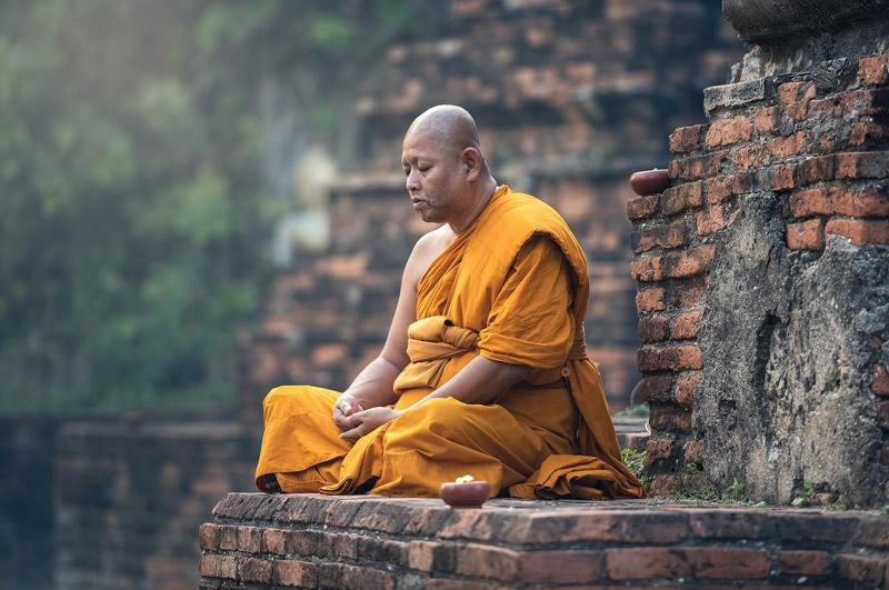 Meditating monk