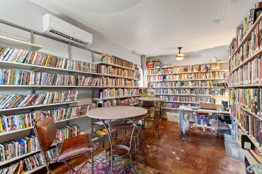 One of the Village's micro-homes has been transformed into a cozy library.