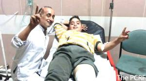 Treating child in Ramallah