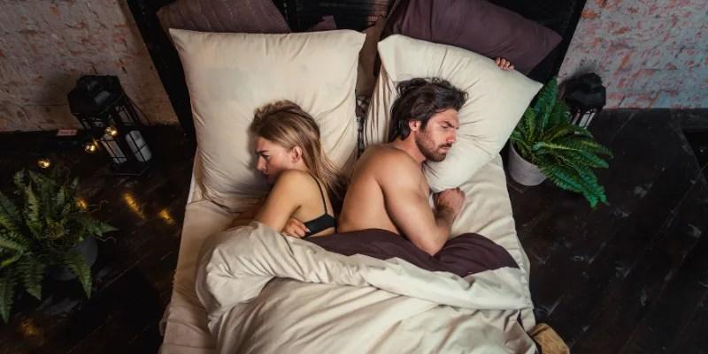 argued-couple-back-in-back-in-bed