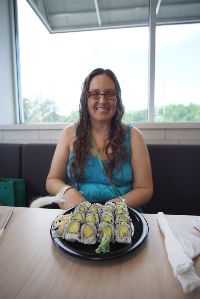 Me with a plate of avocado sushi in front of me, yum!