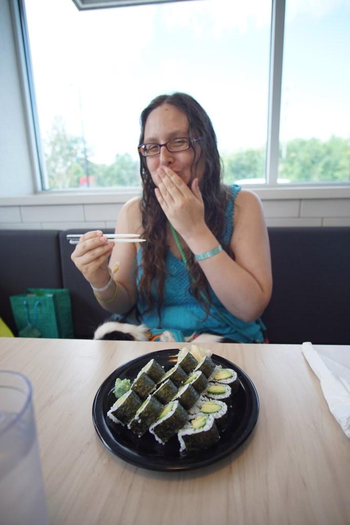 More laughing while trying to eat their sushi!