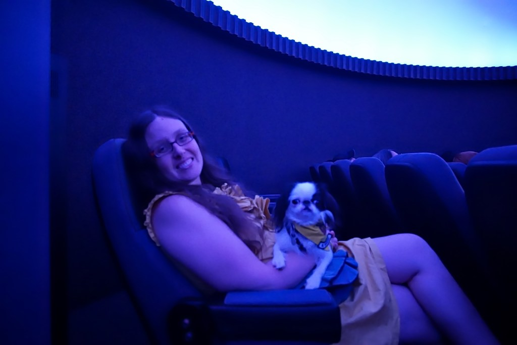 Veronica and Hestia in the planetarium, everything has a blue hue