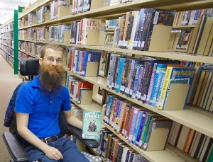 Brad in the library with his Terry Pratchett book