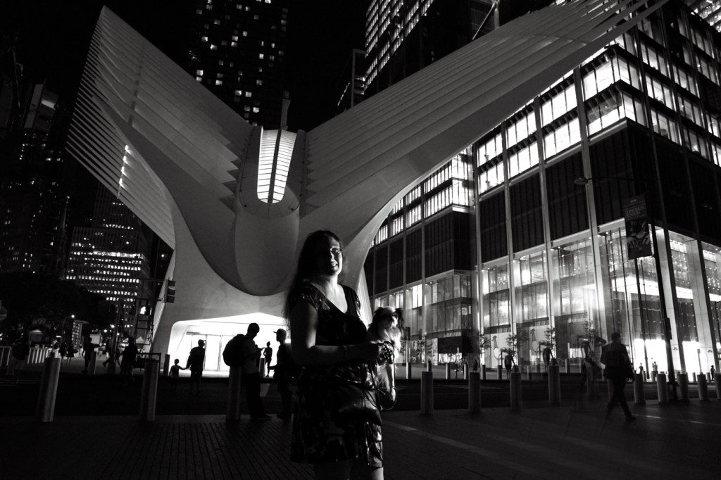 Black and white photo of Veronica and Hestia in front of the Occulus (a large white structure housing a mall type area)