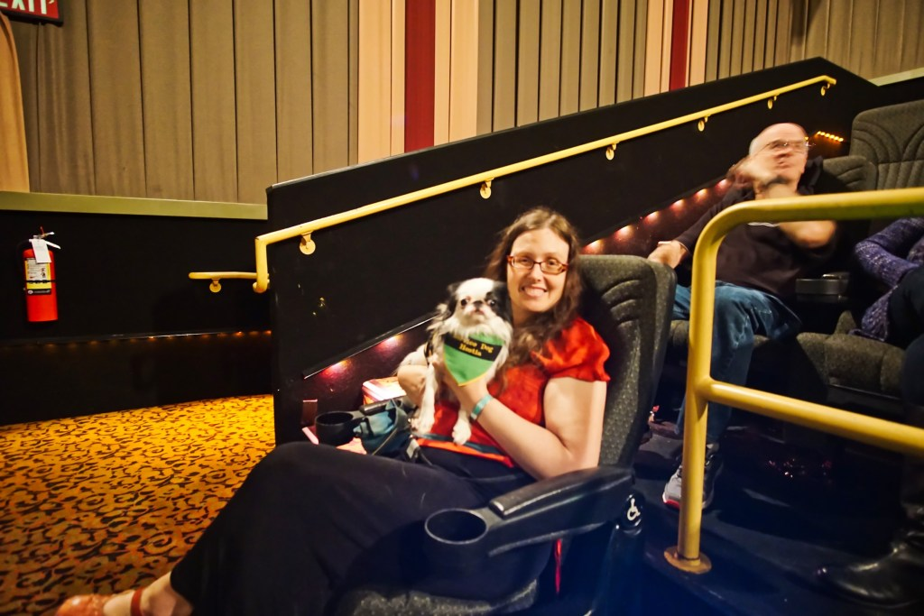 Veronica and Hestia at the movie theater.  Hestia is wearing a green, yellow, and black bandana that was a surprise gift from Brad's mom and dad!  I love gear as gifts!