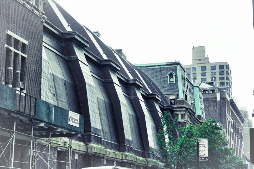 A green tinted photo of interesting architecture in NYC.