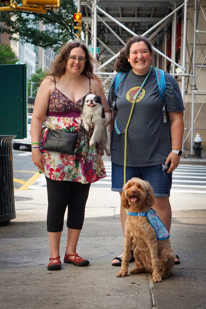Veronica with Hestia and Hannah with Sasha pose on the street before going into the Pressed Juicery.