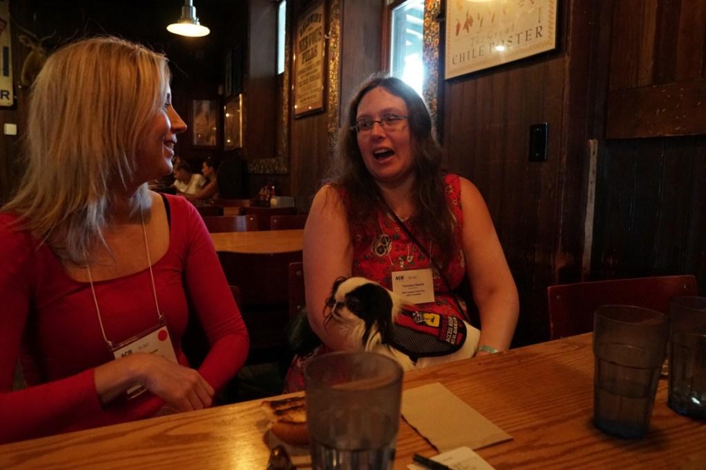 Veronica tells Dana a story, and Dana smiles back.