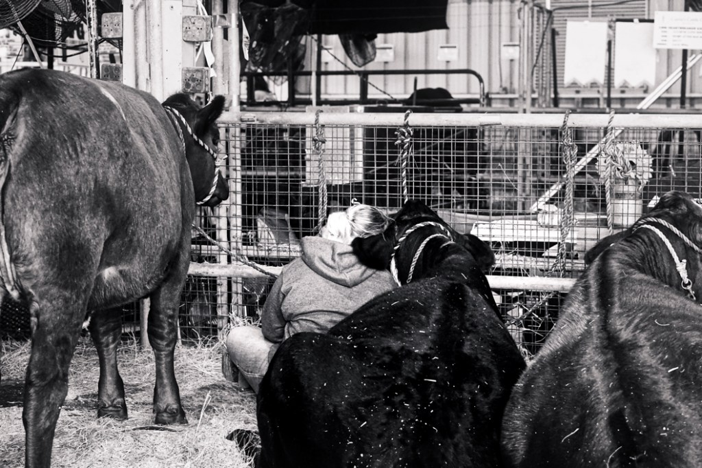 A black and white shot of the cuddling couple.