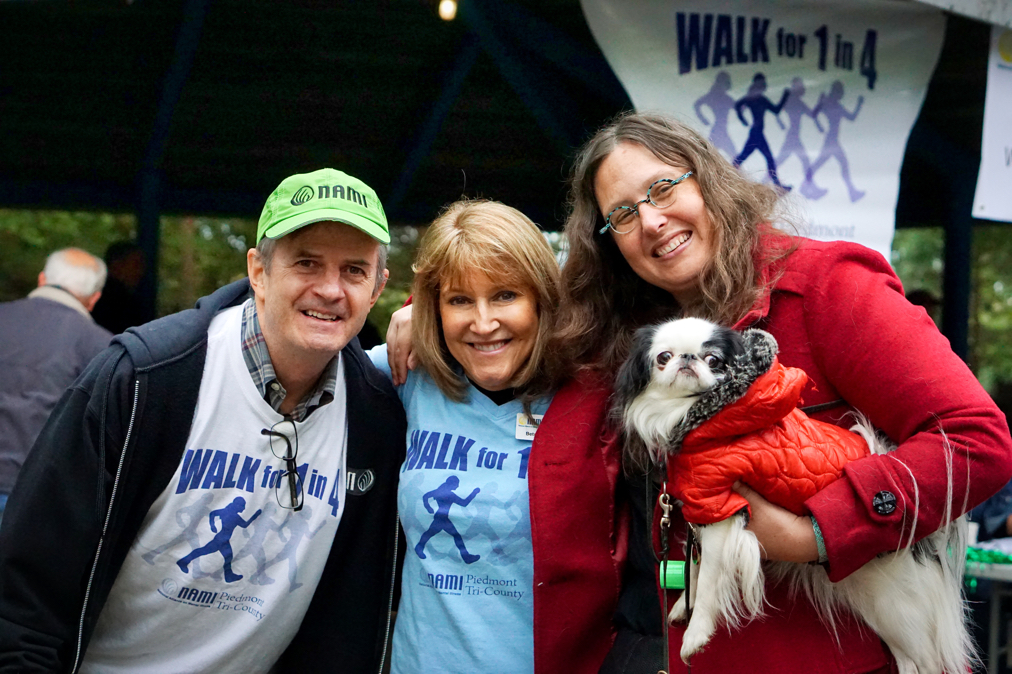 Dan, Betsey, Veronica, and Hestia look at the camera and smile.  Dan and Betsey are wearing NAMI walk for 1 in 4 t-shirts.