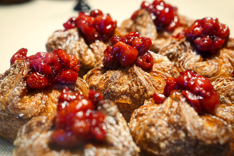 Brad got this close up shot of some baked goods with cranberries on top at Panera.